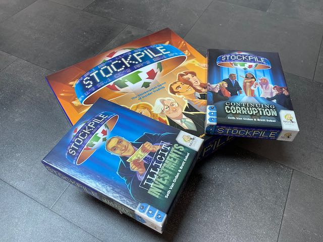Stockpile Board game with both expansion packs.